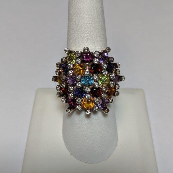 Silver Gemstone Ring. Sterling silver ring containing 19 round gemstones ( Amethyst, Garnet, Citrine, Peridot, Iolite, Grape (rhodilite)Garnet, Blue Topaz, surrounded by round, white Topaz.