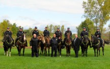 The Mounted Unit poses for a photo with Chief Everette Robbins (center), Officer Mark Perkins (left) and Detective Leo Girard (right).