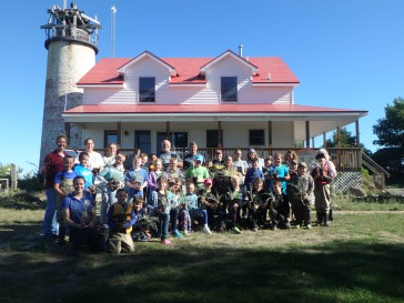 Students are helping Huron Pines restore native plant habitat at Charity Island.