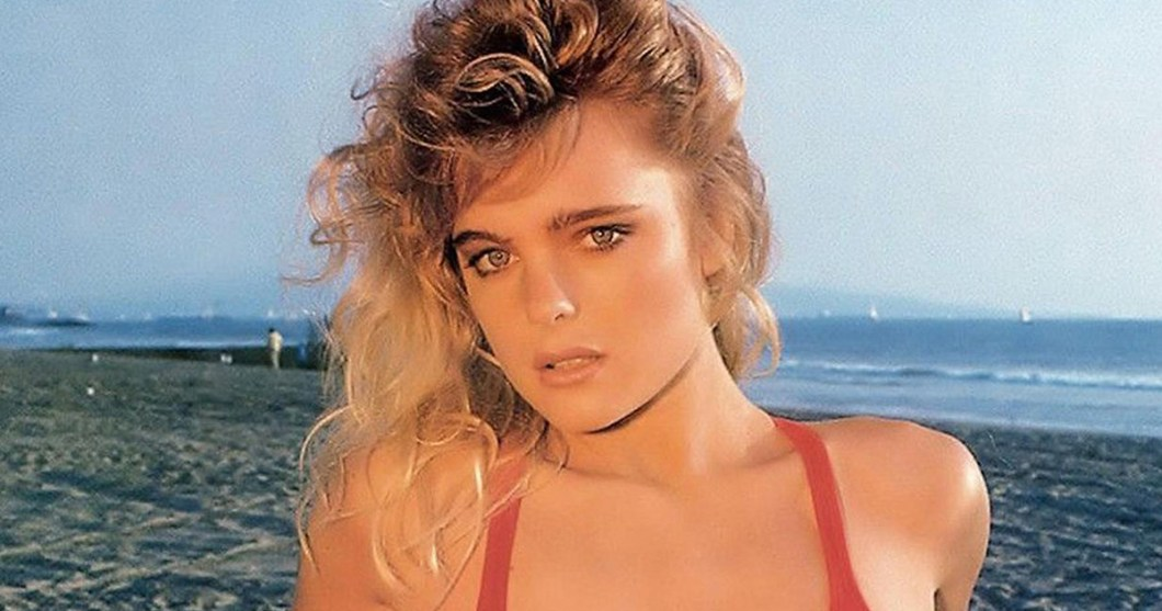 Erika Eleniak at Baywatch beach set in red bathingsuit