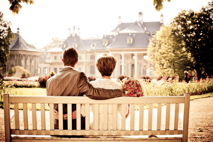 Couple on a bench in park