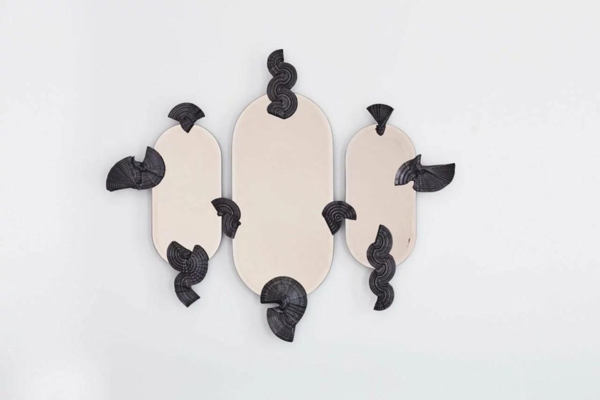 Sculptural wall mirror.