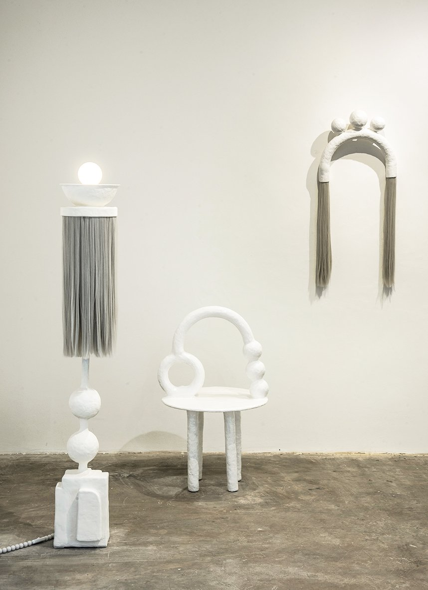 An organic white design furniture collection designed by Brazilian artist Camilla Anunziata.