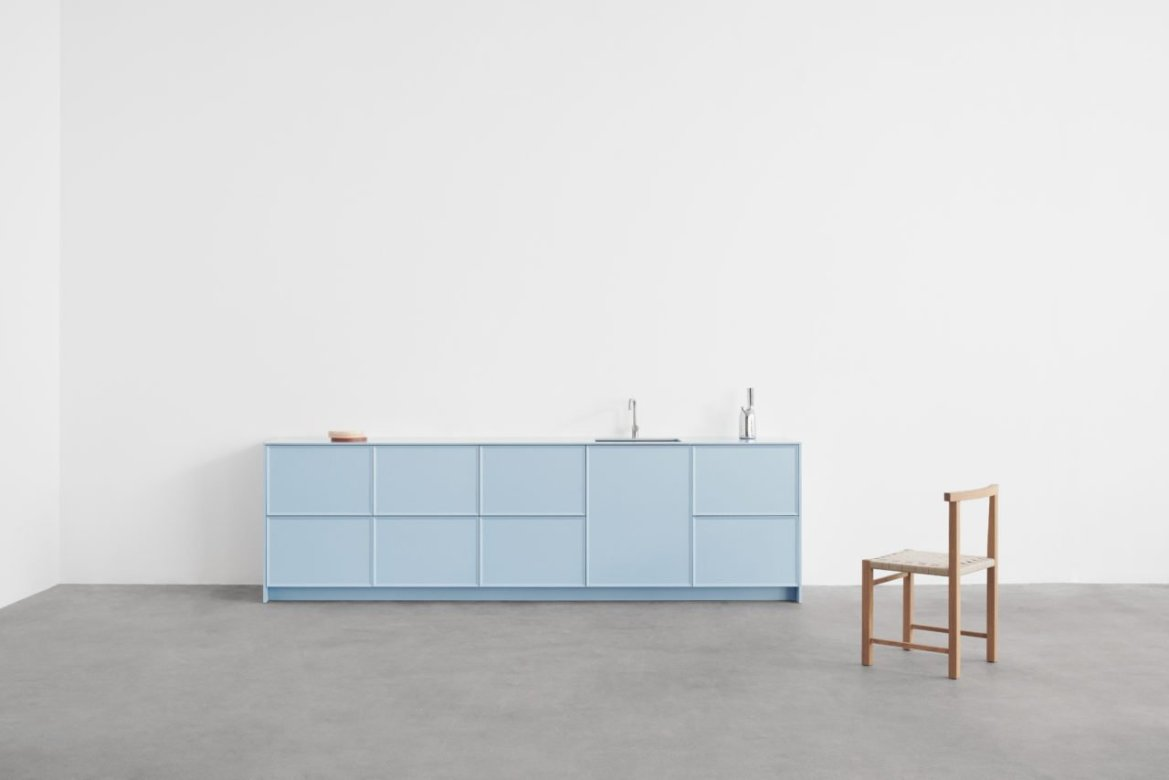 Reform light blue kitchen cabinets by Note Design Studio.