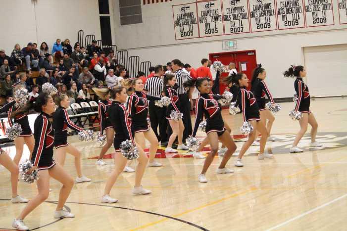 Loud and proud: cheerleaders work hard behind the scenes