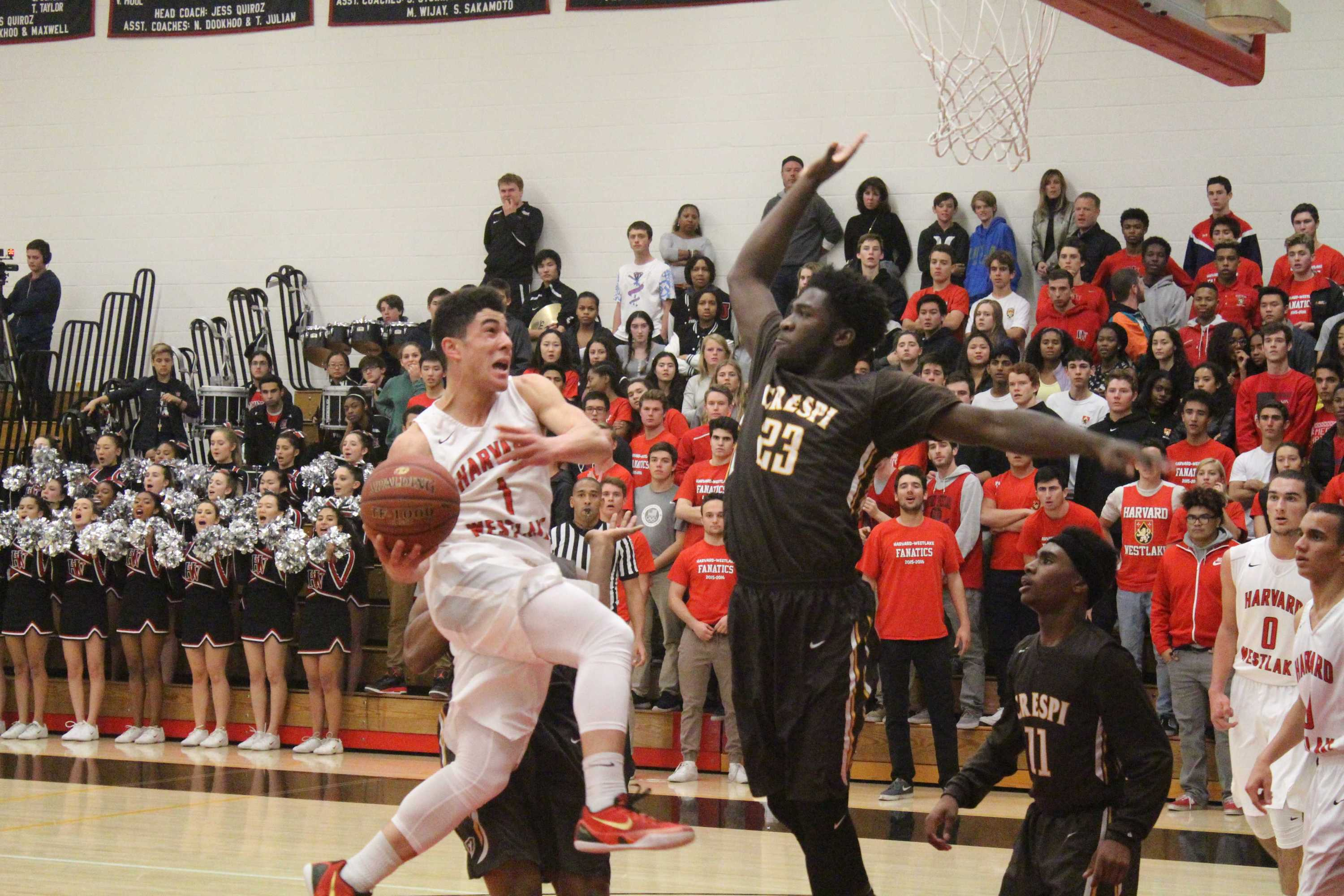 Carter Begel '17 goes up for a layup against a Crespi defender in the Wolverines' 77-75 loss to Crespi on Jan. 6. Credit: Cameron Stine/ Chronicle