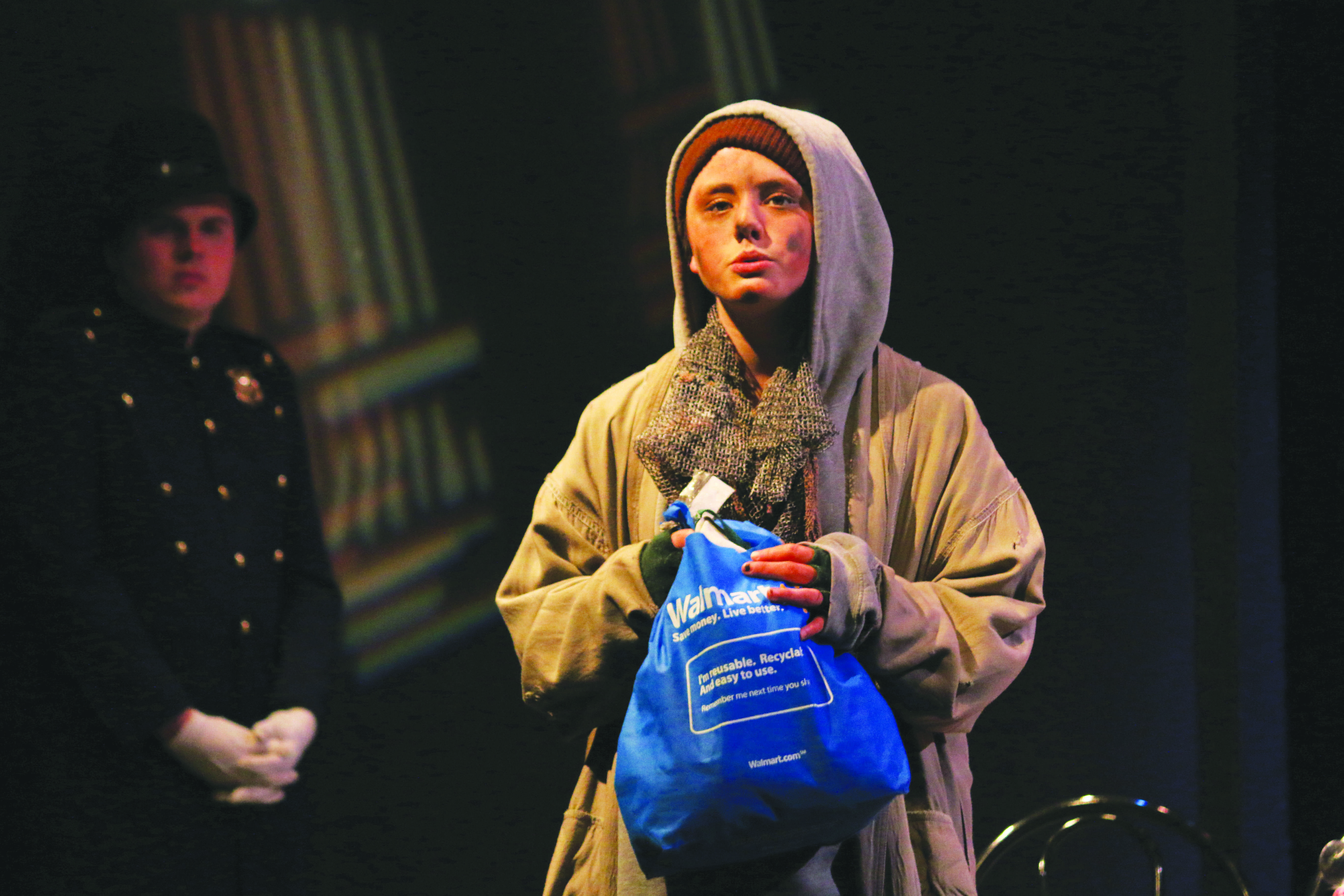 SETTING THE SCENE: Lily Beckinsale-Sheen '17, playing the role of the hobo, laments the state of the world. Credit: Pavan Tauh/Chronicle.