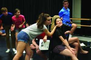 Natalie Musicant '17 praises Angel Hoyang '18 in rehearsal. Credit: Pavan Tauh/Chronicle, Kitty Luo/Chronicle.