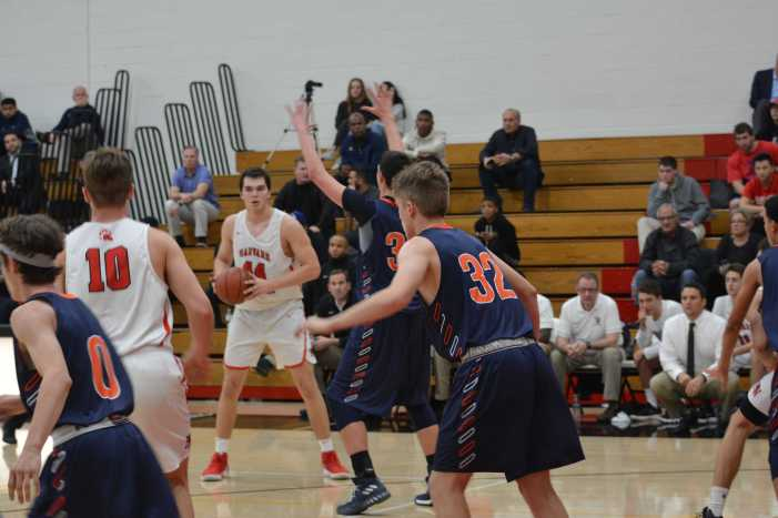 Boys' basketball wins league opener