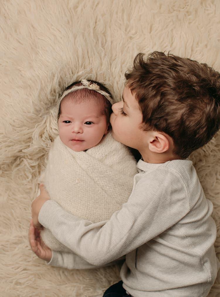 sibling hug Denver newborn photographers
