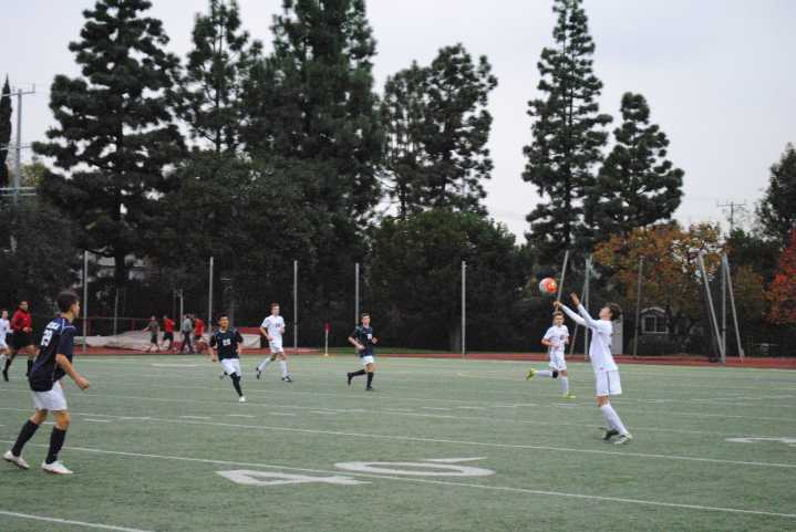 A player on the Varsity team prepares to head the ball. Credit: Casey Kim '20/SPECTRUM
