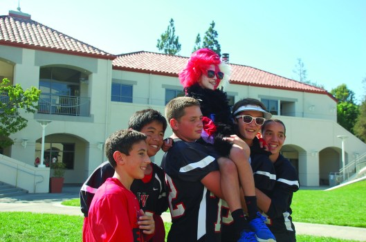 A group of Middle School Football players decked out in the school football gear poses for the camera. Credit: Lauren Nehorai '20 / SPECTRUM