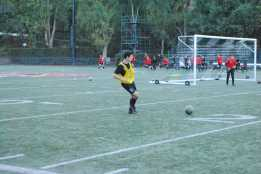 Varsity player Henry Sanderson '20 prepares for a match with a passing drill. Credit: Casey Kim '20/SPECTRUM