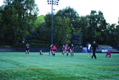 Girls' soccer team practice after school at the Upper School. Credit: Casey Kim'20/SPECTRUM
