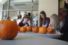 Students decorate pumpkins before the movie starts. Credit: Luke Schneider '20 / SPECTRUM