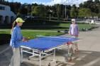 Sophia Ekstrand '20 and Erica Ekstrand '20 play a game of table tennis. Credit: Luke Schneider '20 / SPECTRUM