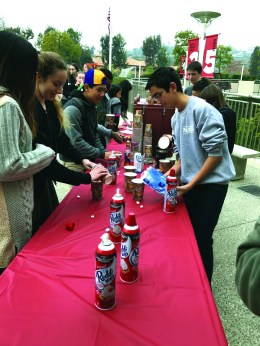 9th grade Senator Michael Lehrhoff '20 serves hot chocolate to students during Winter Week. Credit: Zoe Redlich '20 / SPECTRUM