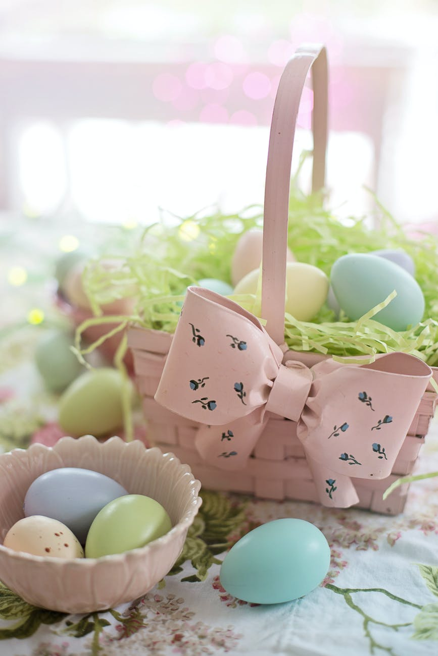 pink basket filled with easter eggs