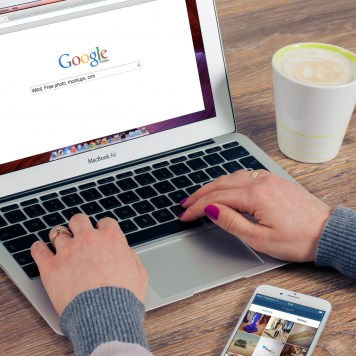 woman using laptop for search - SEO