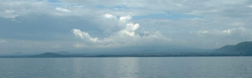 Lake Kivu on a calm day, overlooking the volcano