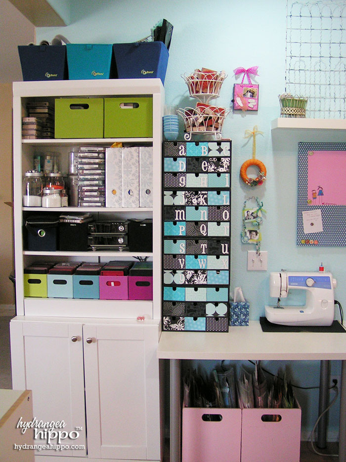 Die cut center, sewing area, storage, and Ikea FIRA boxes in Jennifer Priest's Scrapbook Room.
