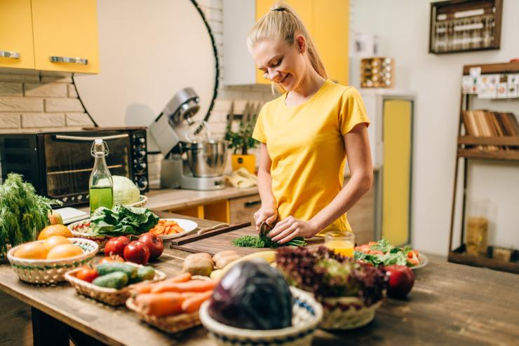 Housewife cooking organic food preparation to  Stay Healthy