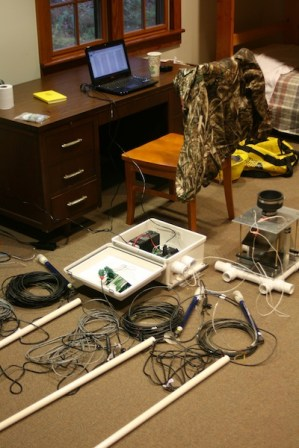 Wiring soil moisture/temperature probes, tensiometers, and tipping bucket to the data logger in the dorm room.
