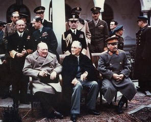 Winston Churchill at the Yalta Conference, with Roosevelt and Stalin beside him