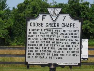 """The """"Chapel Above Goose Creek"""", built by the vestry of Truro Parish in 1736. Augustine Washington, father of George Washington, was a member of the vestry at the time. This was the first church on the soil of Loudoun County, Virginia, erected as a chapel of ease for the benefit of early settlers. The marker was erected 1935 by Conservation & Development Commission (Marker Number F-7)."""