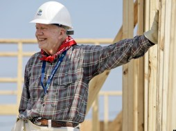 Former President Jimmy Carter leans on a wall as he helps build a Habitat for Humanity house in Violet, Louisiana (21 May 2007). Carter was working on the 1000th Habitat for Humanity house in the Gulf Coast region since hurricane Katrina and Rita. (AP Photo/Alex Brandon)