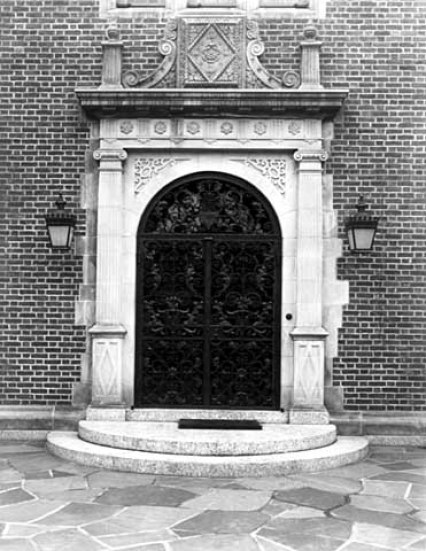 Front door, main entrance showing hand-wrought iron gates