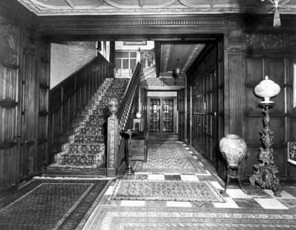 The grand stairway and side hall