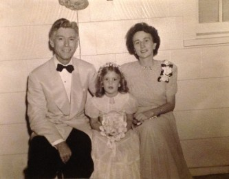 Penny Walholm, flower girl at the wedding of her cousin Jane Watkins & Bob Escher, 12 Aug 1944 - with her parents
