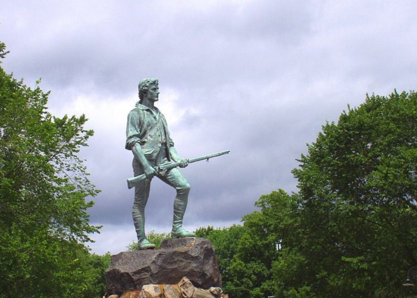 """The Minuteman"" (1900) by Henry Hudson Kitson stands at the town green of Lexington, Massachusetts."