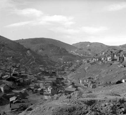 Central City, Colorado, stands in the distance in this view taken from Bates Hill looking west. The St. Aloysius Academy, a Catholic school, stands on Gunnell Hill above St. Mary's Catholic Church. Houses and other buildings stand in the midground. (Denver Public Library Digital Collections, 1899?)