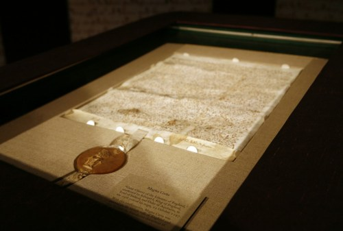 An original version of the Magna Carta on display at Sotheby's auction house in New York is shown on 17 Dec 2007. An edition of the document from 1300 was discovered in a town archive in England. (Photo by Shannon Stapleton/Reuters)