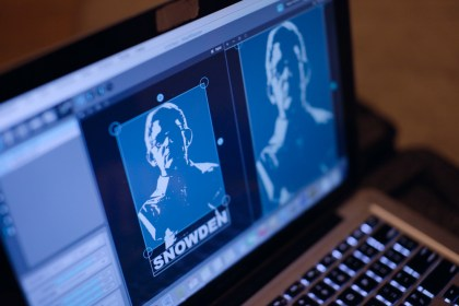 "Artists with the group ""The Illuminator"" use a laptop to cast an image of Edward Snowden over the spot where sculpture of the NSA leaker once stood on Monday, 7 Apr 2015. (photo credit: ""The Illuminator"")"