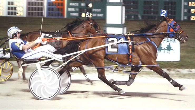 Kaydon Begone winning a race at Maywood Park on August 23, 2013
