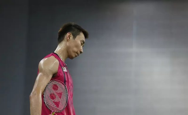 Malaysia's Lee Chong Wei reacts after losing a point against Vietnam during the men's singles quarter final badminton match at Gyeyang Gymnasium, at the 17th Asian Games in Incheon