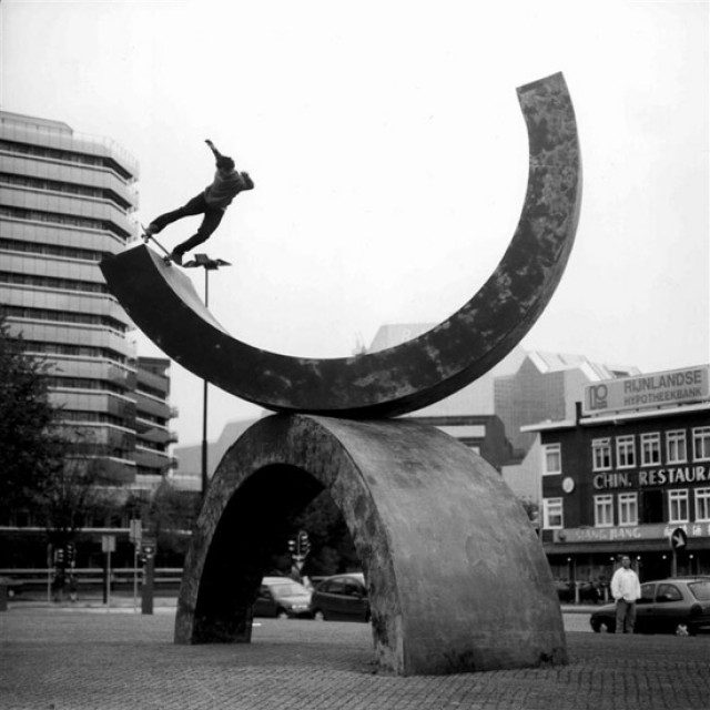 Skateboarding on modernist sculpture
