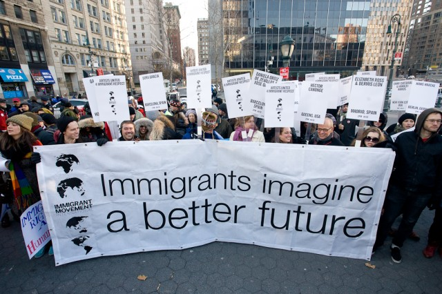 Creative Time staff, Tom Finkelpearl, Tania Bruguera and more marching for Immigrant Movement International. Image from Creative Time website.