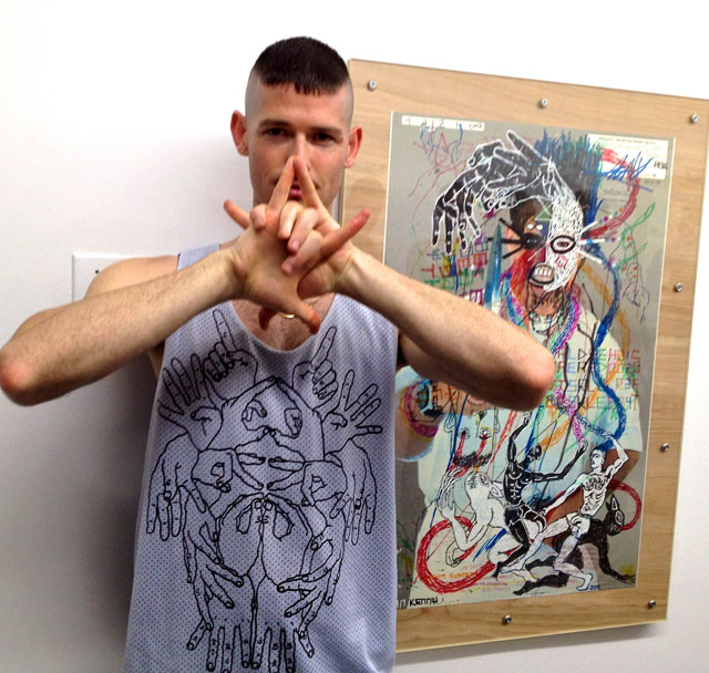 Artist Brian Kenny with his work
