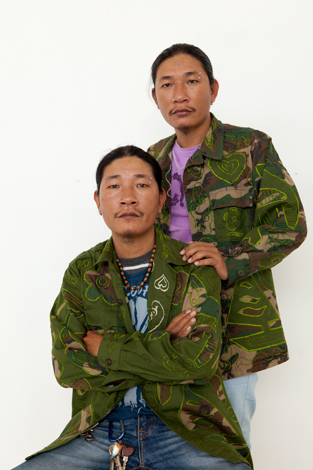 Thanh (seated) and Hai (standing) in the hybrid uniforms