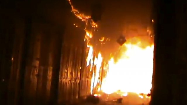 A screenshot of BBC video shows Aleppo's ancient souk engulfed in flames. (via BBC)