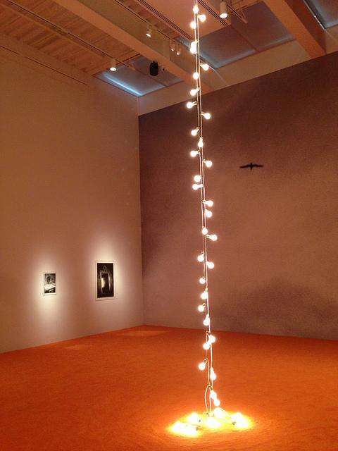"""Felix Gonzalez-Torres, """"Untitled (Couple)"""" (1993), in front of """"Guaimaro, Cuba"""" (1992-93)"""