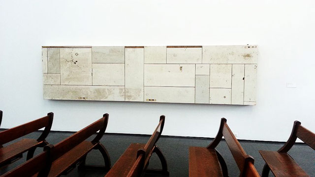 """Pews in the atrium, part of Theaster Gates's """"13th Ballad"""" at MCA Chicago"""
