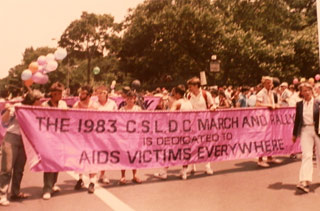 "David Bookstaver/Associated Press, gay pride parade in New York City with marchers carrying a banner dedicated to ""AIDS victims everywhere,"" July 26, 1983 (click to enlarge)"