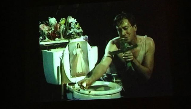 Photo of film screening John Fleck performing in his work Blessed are all the Little Fishes, 1989.  (Source: New Museum)