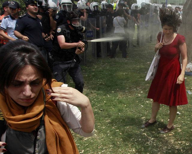 The now infamous image by Reuters photographer Osman Orsal was taken in Istanbul last week in the midst of protests against Turkish PM Tayyip Erdogan's plans to raze a public park to build a mall. (photo via reuters.com)