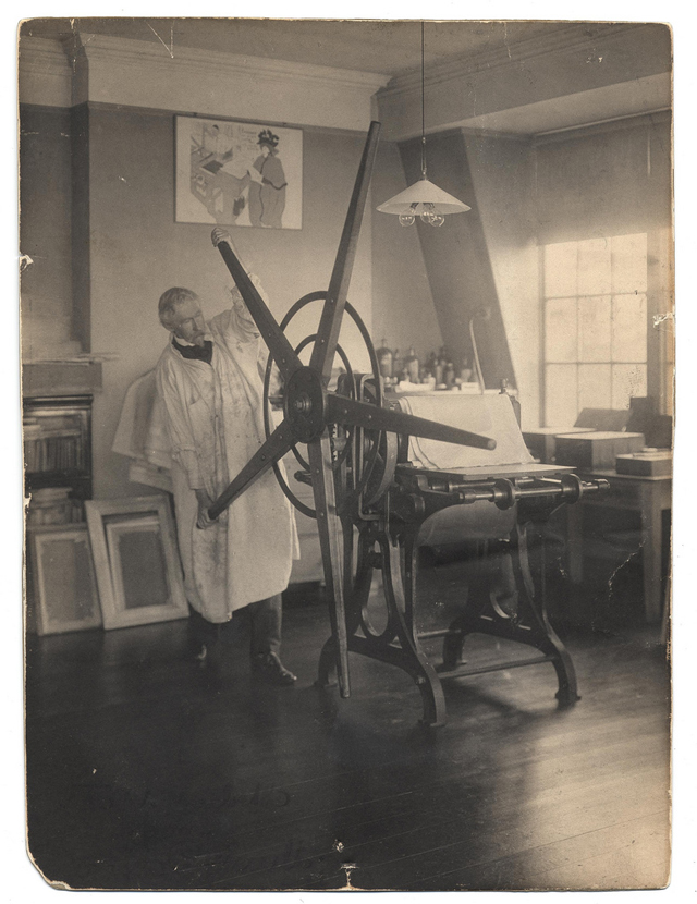 Joseph Pennell working a printing press in his studio (photograph by Joseph Klima, Jr., via Smithsonian Institution)